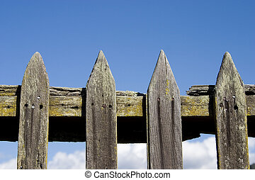 Rustic Fence - A rustic picket, fence in a small town.