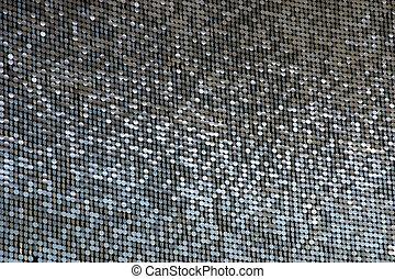 Shiny Circles - Lots of shimmering circles hanging on a...