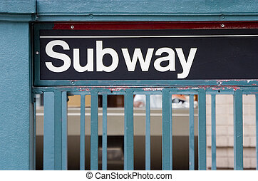 Subway Sign - A subway sign at a sidewalk entrance, in New...