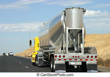 Tanker truck on the road - A tanker truck transports some...