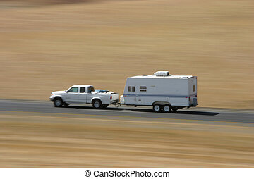 Trailer Hauling Truck - A pickup truck hauls a family...