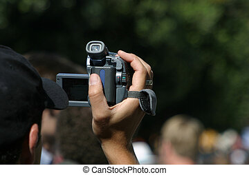 Videotaper - A man videotapes an event