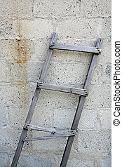 ladder against brick wall - old wooden ladder with broken...