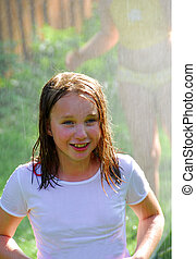 Girl and sprinkler - Girls running though a sprinkler