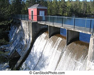 Dam with sluice house and waterfall. Built in 1930