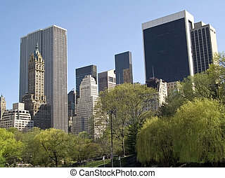 Park View - Tall buildings overlook Central Park in...