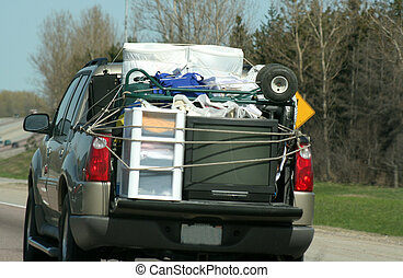 Highway Move - A truck loaded for moving, travelling on the...
