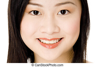 Face Close-up - A close-up portrait of a pretty young asian...