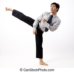 Karate Kick - A young asian businessman does a high karate...