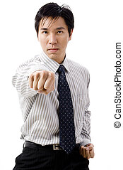 Business Punch - A young asian businessman does a karate...