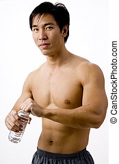 Bodybuilder - A well-built asian man holding a water bottle