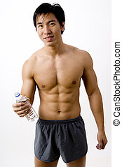 Asian Fitness - A well-built young asian male holding a...
