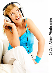 Listening music - Young beautiful happy women listening...