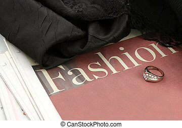 fashion news - fashion section of newspaper, ring, and...