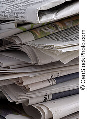 Newspapers - Close-up of jumbled pile of yesterday\\\'s...