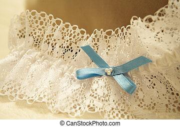 Wedding #35 - Close-up of a wedding garter.  Shallow D.O.F