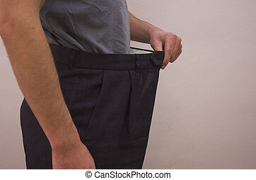 Beat the Bulge - Close up on slimmed down male waistline...