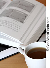 Investment - A cup of coffee and an investment book