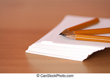 Blank notes - A stack of paper and pencils