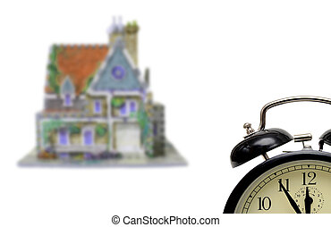 house with alarm-clock set five to twelve,isolated on white...