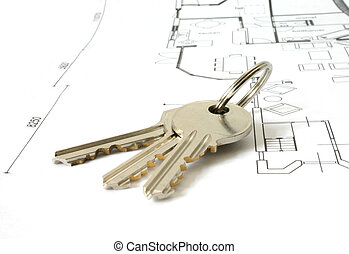 keys on an architecture-plan - bunch of golden keys on a...