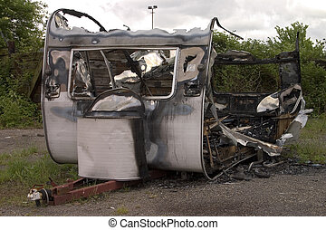 Torched RV - Remains of a badly burned trailer
