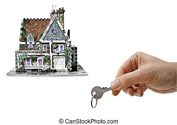 house and key - house with hand and key, a new home isolated...