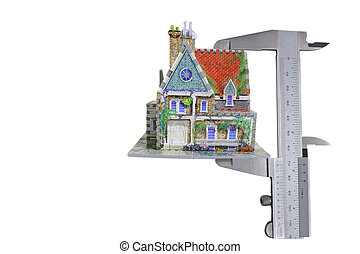 mortgage - house with calipers isolated on white background...