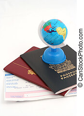 travel necessities - travel documents and globe
