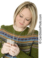 Digital Music - Young woman listening to digital music.