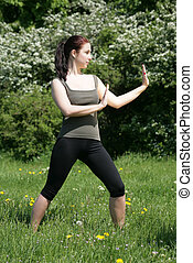 chi-gong - girl training an asian sport in de nature