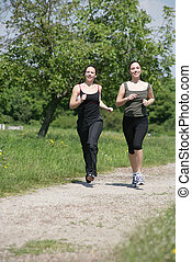 jogging - two girls are jogging in the nature