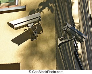 Two security cameras on the wall