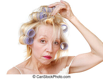 Curler Woman - A blonde woman curling her hair with lavender...