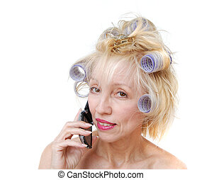 Curler Woman - A blonde woman with lavender curlers in her...