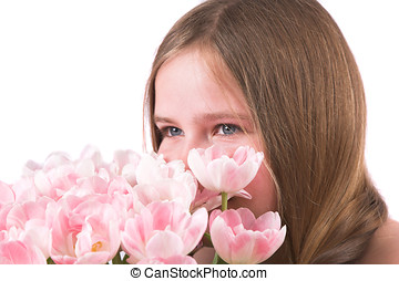 Smelling the tulips - Pretty ten year old girl smelling the...