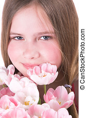 Behind the pink tulips - Pretty ten year old girl behind a...