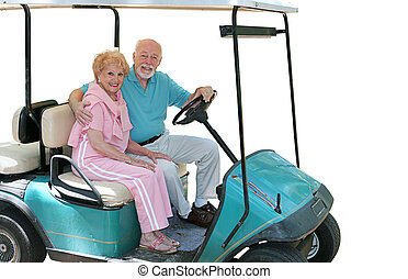Golf Cart Seniors Isolated - An attractive senior couple in...