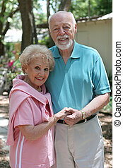 Senior Couple Outdoors - An attractive senior couple taking...