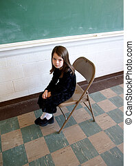 School Troubles - Little girl sitting in front of the class...