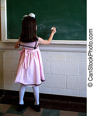 Girl at School - Little girl writing on chalk board