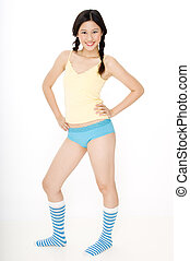 Confidence - A confident young woman in socks shorts and...