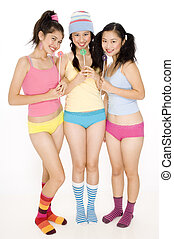 Girlfriends - Three pretty asian women in colorful clothing