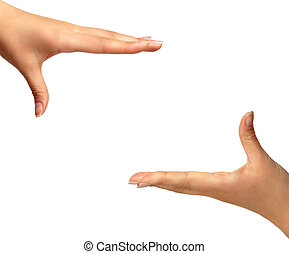 Framing hands isolated background - Two female hands framing...