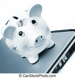 Internet Banking Concept Piggy bank over laptop