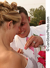Groom taking out some roses - Groom helping his bride take...