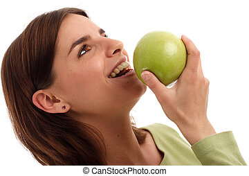 Green apple - Healthy food; young woman eating green apple