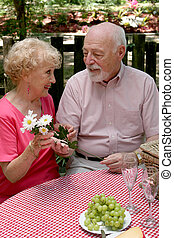 Picnic Seniors - Flowers For Her - A romantic senior man...