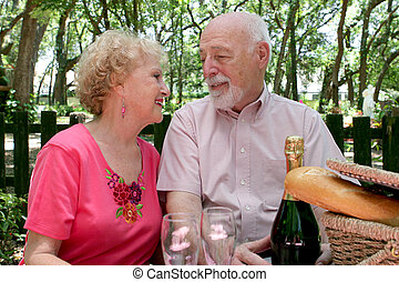 Picnic Seniors - In Love - A senior couple enjoying a...