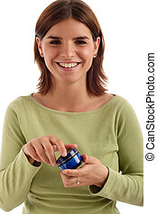 Beauty product - Portrait of a young pretty woman holding...